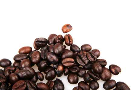 Coffee Beans isolated on white. Фото со стока