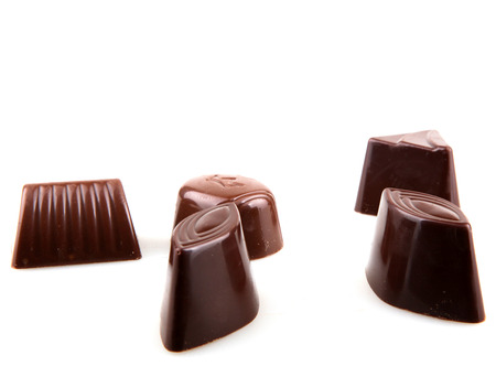 Sweet chocolates isolated on white background.