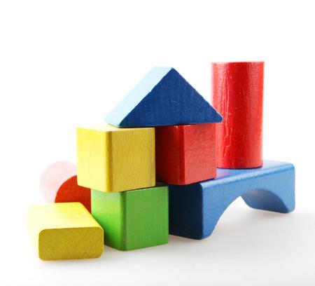 Studio Shot Of Colorful Toy Blocks Against White Background