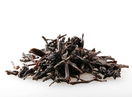 Black Dry Tea Leaves Isolated On White Background