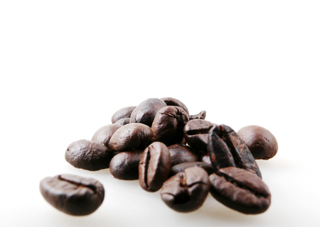 Roasted Coffee Beans Against White Background Stock Photo