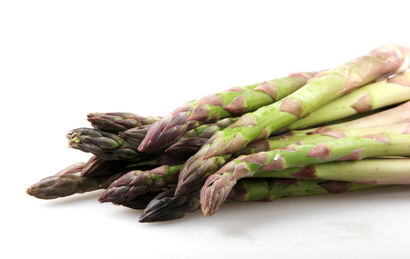 Close-Up Of Asparaguses Against White Background