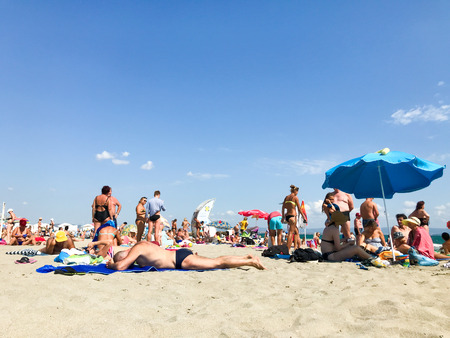 Pomorie, Bulgaria - September 01, 2019: People Relaxing On The Beach.