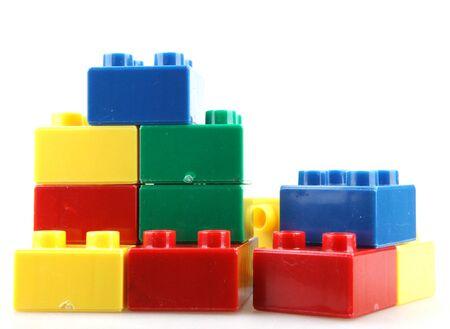 Close-Up Of Plastic Building Blocks Against White Background