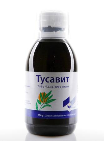 AYTOS, BULGARIA - JANUARY 28, 2014: Liquid medicine in glass bottle - Tusavit. Sajtókép