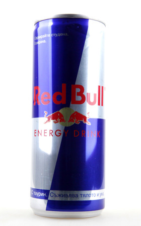 AYTOS, BULGARIA - JANUARY 25, 2014: Red Bull bottle can isolated on white background. Red Bull is an energy drink sold by Austrian company Red Bull GmbH, created in 1987. Editorial
