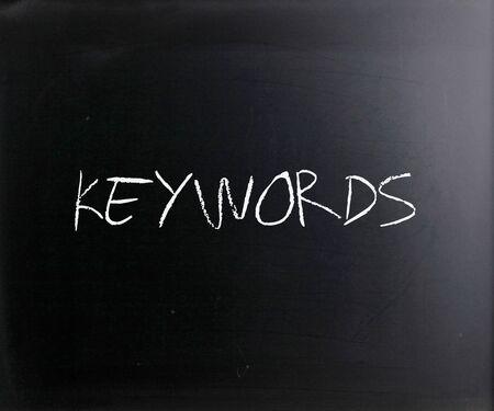 """Keywords"" handwritten with white chalk on a blackboard."