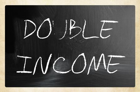 Text DOUBLE INCOME on a blackboard