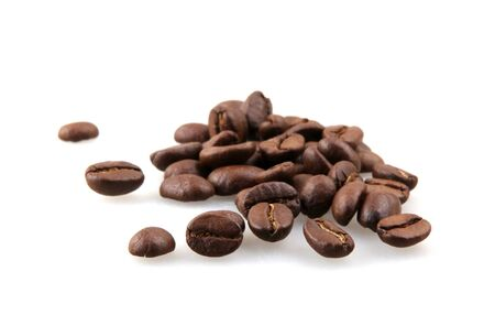 Coffee beans isolated on white background. A coffee bean is a seed of the Coffea plant and the source for coffee Imagens