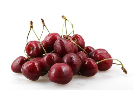 Sweet cherry isolated on white background. A cherry is the fruit of many plants of the genus Prunus, and is a fleshy drupe (stone fruit)