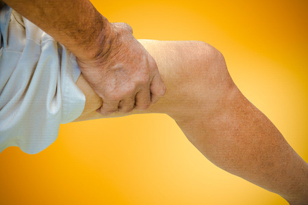 anklebone: Close up suffering old male pain in shin on background. Stock Photo