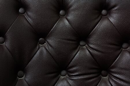 buttoned: Buttoned on the black Texture. Repeat pattern Stock Photo