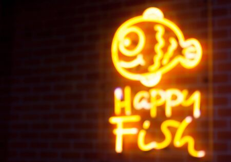 neon fish: Blurry text fish neon light on wall