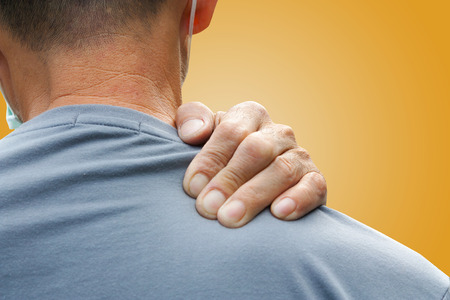 back rub: Old man with shoulder pain