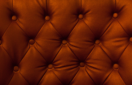 buttoned: Buttoned on the orange Texture. Repeat pattern Stock Photo