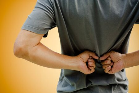 back ache: man having a back ache