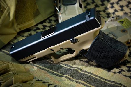 glock: 9mm semi-automatic pistol on background.