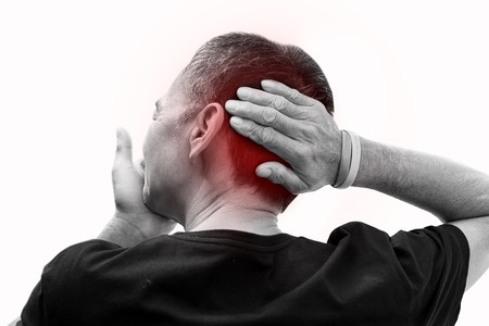 old man on a physical pressure: Old man hand holding he head and massaging in pain. Stock Photo