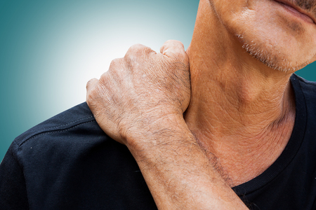 old man on a physical pressure: Old man has pain in right neck