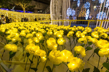 BANGKOK, THAILAND - DECEMBER 15, 2016 : Centralworld shopping mall at night, the themes marigold flower welcome to Christmas and Happy New Year 2017 festival. Editorial