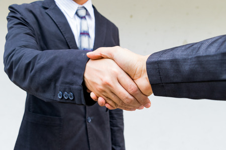 The double exposure handshake businees and city Stock Photo