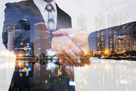 businees: The double exposure handshake businees and city Stock Photo