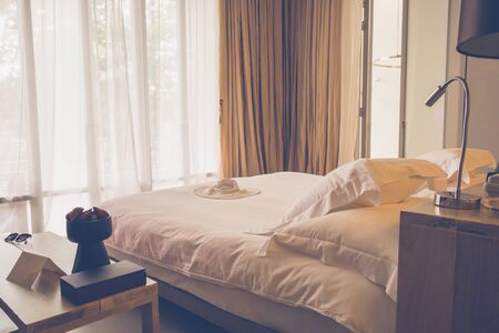 luxury apartment: Hotel or resort bedroom in minimalist interior design, with bed in classic bedroom style.