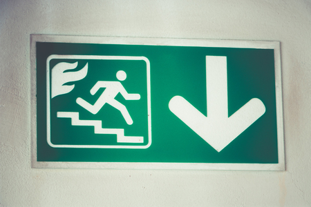 Fire exit symbol at comany in building.