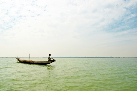 chilika: A fishermen fish for food in the worlds largest Salt water lake on September 01, 2012 in Chilika, Orissa, India.