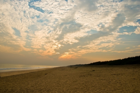 Tropical beach with dramatic sky and clouds in Chilika, India  photo