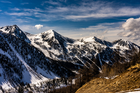 snowy mountains panorma in french alps, france
