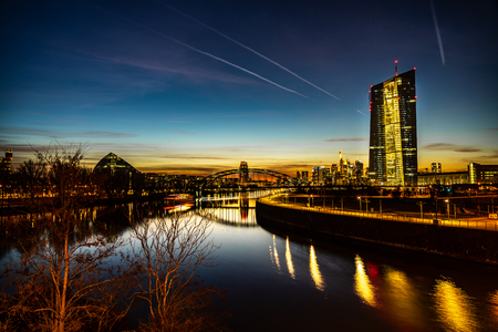 view on frankfurt skyline and  european central bank at sunset