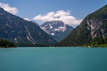 view on lake plansee and tauern in austrian alps, tyrol, austria Standard-Bild