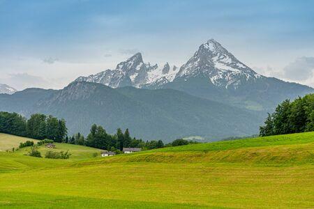 view of bavarian alps landscape with Watzmann peak in the background, National Park Berchtesgadener Land, Bavaria, Germany Фото со стока