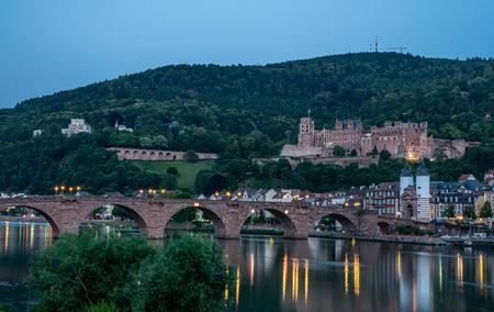 view on HHeidelberg castle ruins, karl theodor bridge (old bridge) and neckar river, germany Editorial