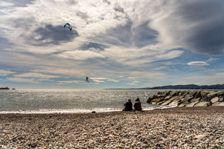people watching a kite surfer in actionon french riviera in saint raphael, france