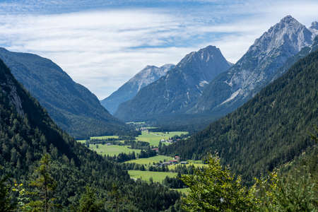 view on wetterstein mountains and leutasch valley from a nearby mountain in summer, bavaria, germany Фото со стока