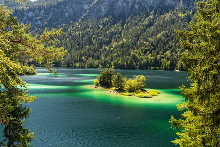 View on beautiful island in the eibsee in front of the zugspitze mountain, bavaria, germany