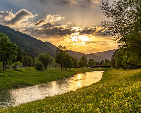 sunset at the ammer river bank in Oberammergau, Germany Standard-Bild