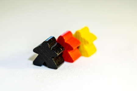 German country and people represented by black, red, yellow figurines made from wood Imagens