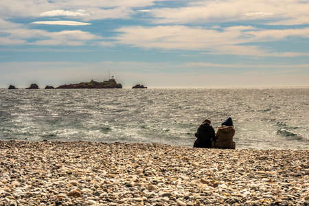 people watching waves of mediterranean sea at french riviera in saint raphael, france