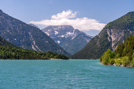view on lake plansee and tauern in austrian alps, tyrol, austria
