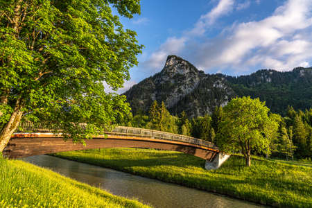 bridge at sunset at the ammer river bank in Oberammergau, Germany