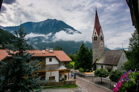 Ancient church in a mountain scenery in South Tyrol Stock Photo