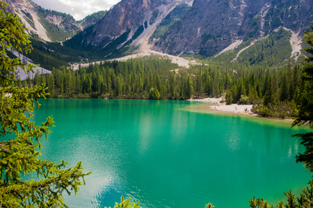 Torquoise lake in a mountain valley in South Tyrol Stock Photo