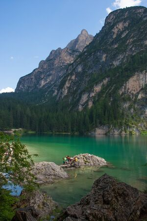 Braies lake under the Alps with turquoise water