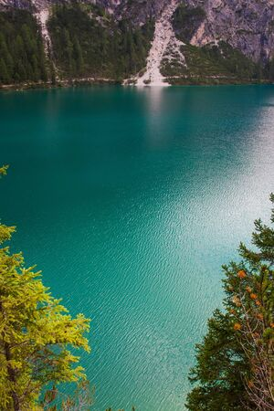 Braies under the Alps with turquoise water Stock Photo