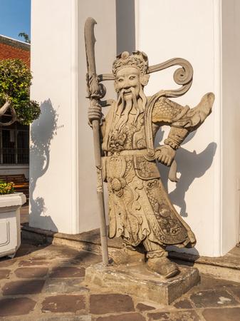 Royal Palace: Stone statue in the royal palace of Bangkok Thailand Editorial