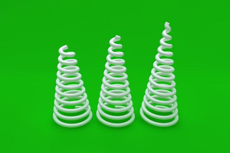 spiralling: White coil spring on green background Stock Photo
