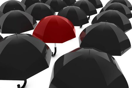 Red umbrella with many black umbrellas photo